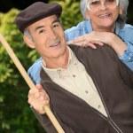 Senior couple in the garden — Stock Photo