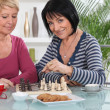 Female friends playing chess over coffee — Stock Photo