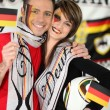 Couple supporting Germany team - Stock Photo