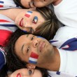 Four French football supporter laying together — Stock Photo