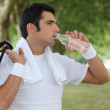 Man drinking water after a workout — Stock Photo #10121579