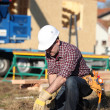 Carpenter in construction site — Stock Photo
