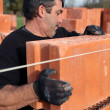 Stock Photo: Builder laying bricks