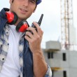 Foreman with radio on site — Stockfoto