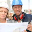 Architect and builder on site with plans — Stock Photo #10122114