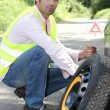 Man with a puncture — Stock Photo