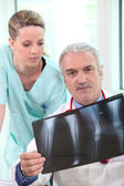 Orthopedic surgeon and assistant — Stock Photo