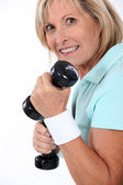 Woman with weights — Stock Photo