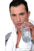 Man drinking water after work-out — Stock Photo
