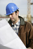 Foreman on site making sure build is going according to plan — Stock Photo