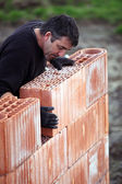 A tradesman laying a brick — Stock Photo