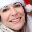 Woman in a Santa hat — Stock Photo
