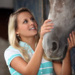 Teen stroking horse — Stockfoto #10152717