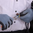 Close-up on gloved hands of electrician at work — Stock Photo