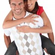 Foto Stock: Mgiving girlfriend piggyback