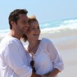Happy couple on the beach — Stock Photo #10154221