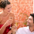 Couple drinking champagne in restaurant — Stock Photo