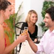 Couple toasting in restaurant — Stock Photo #10154682