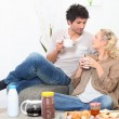 Couple with breakfast — Stock Photo