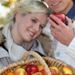Couple with basket of apples — Stock Photo #10154975
