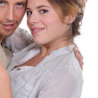 Young attractive couple hugging — Stock Photo