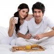 Couple having breakfast in bed — Stock Photo #10155159