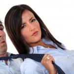 Woman pulling man's tie — Stock Photo
