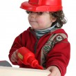 Little boy with toy drill pretending to be workman — Stock Photo #10155471
