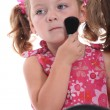 Child putting on makeup — Stockfoto