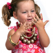 Stock Photo: Adorable little girl with plenty of jewelry.