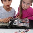 Two young children stamp collecting — Stock Photo