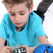 Little boy playing with toy cars — Stock Photo