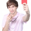 Boy showing red card — Stock Photo