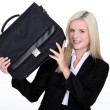 Businesswoman holding a briefcase — Stock Photo