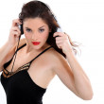 Nice brunette listening to music. — Stock Photo #10158409