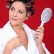 Stock Photo: Womwith curlers