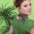 Girl with a plant and a rack — Foto Stock