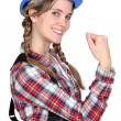 Stock Photo: Female construction worker showing her strength