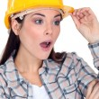 Shocked female construction worker — Stock Photo