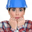 Royalty-Free Stock Photo: Scared female construction worker