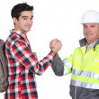 Men shaking hands — Stock Photo