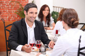 Couple in restaurant — Stock Photo