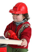 Little boy with toy drill pretending to be workman — Photo