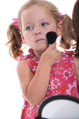 Child putting on makeup — Stock Photo