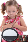 Young girl playing with mommy's jewelry — Photo