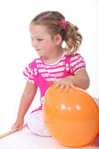 Little girl playing with balloon — Stock Photo