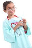 Girl dressed as doctor — Stock Photo