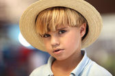 Blond boy with straw hat — Stock Photo