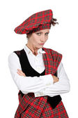 Unsatisfied woman crossing arms and wearing Scottish clothes — Stock Photo
