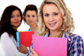 Students stood with folders — Stock Photo